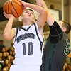 (Brad Davis/The Register-Herald) Westside's Isaiah Lester drives to the basket as Wyoming East's Dylan Brehm defends Friday night in Clear Fork.