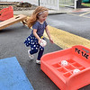 (Brad Davis/The Register-Herald) Youngster Makyria Lester, 3, runs around thre gaming area during a community picnic at Greenbrier Estates Friday afternoon. Property manager Michelle Bennett, leasing agent Phil Spurlock and other facility officials threw a cook-out style gathering with games for kids and a visit from West Virginia Miners mascot Miner Mike.
