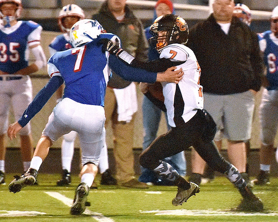 (Brad Davis/The Register-Herald) Summers County quarterback Tucker Lilly tries to fend off Midland Trail defender Colton Yoder after getting around the edge for a gain Friday night at Nicholas County High School.