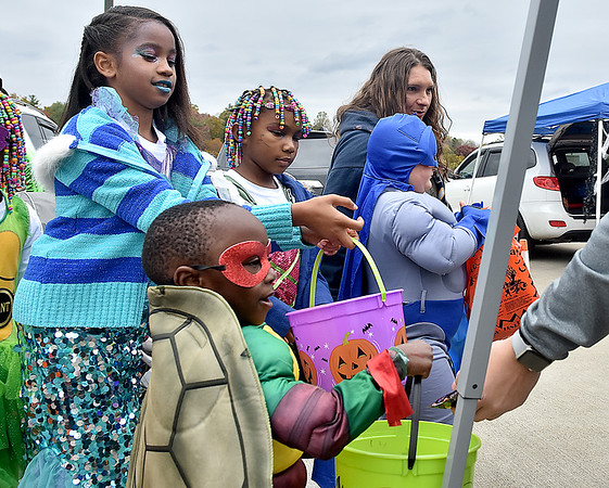 (Brad Davis/The Register-Herald) Costume-clad youngsters accumulate all the candy they can during Tailgate Halloween Saturday afternoon atop Beckley's Intermodal Gateway.