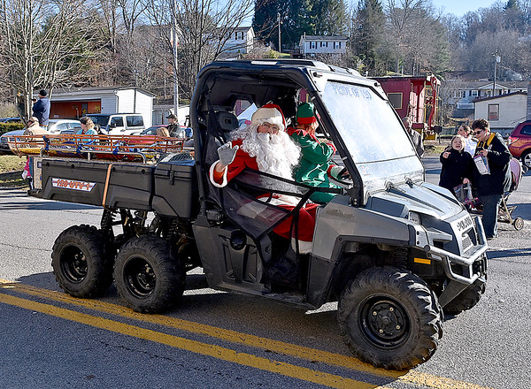 (Brad Davis/The Register-Herald) Santa hitches a ride in a Sophia City Volunteer Fire Department off road rescue vehicle during the town's annual Christmas Parade Saturday afternoon.