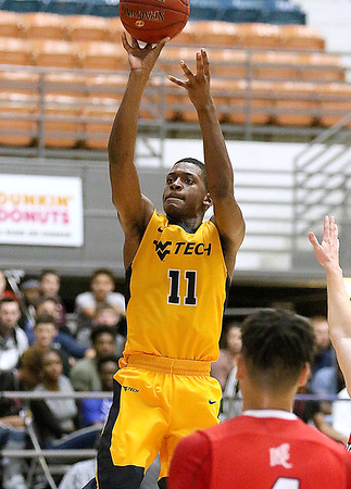(Brad Davis/The Register-Herald) WVU Tech's Thomas Collins shoots from three-point range against Davis & Elkins Saturday afternoon at the Beckley-Raleigh County Convention Center.