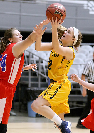 (Brad Davis/The Register-Herald) WVU Tech's Alexandra Combs drives and scores as Bluefield College's Haley Turman defends during the team's first ever home game at the Beckley-Raleigh County Convention Center Wednesday night.
