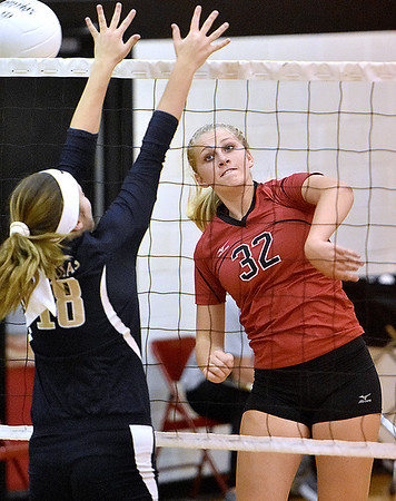 (Brad Davis/The Register-Herald) PikeView's Laken McKinney spikes the ball as Nicholas County's Kate Belmont blocks it during a volleyball match at Liberty High School Wednesday night.