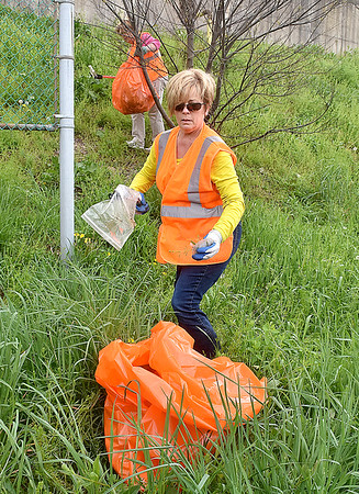 (Brad Davis/The Register-Herald) Volunteer Beth Jarrell, near, and her partner Sharon Lilly work their way along Pikeview Drive looking for items of garbage during Raleigh County Make-It-Shine's Spring litter sweep Friday afternoon.