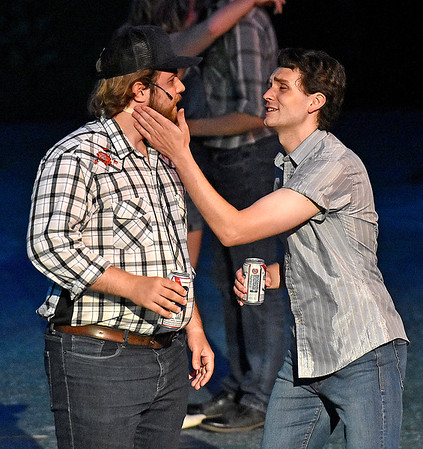 (Brad Davis/The Register-Herald) Ren (right), played by Holden Akers-Toler, encourages friend Shere Khan, played by Brooks Cline, during a scene from Theatre West Virginia's Footloose at Grandview Park's Cliffside Amphitheatre.