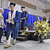 (Brad Davis/The Register-Herald) Graduating Nicholas County High School seniors collect their diplomas during the school's 103rd Commencement Ceremony Sunday afternoon at the Summersville Arena