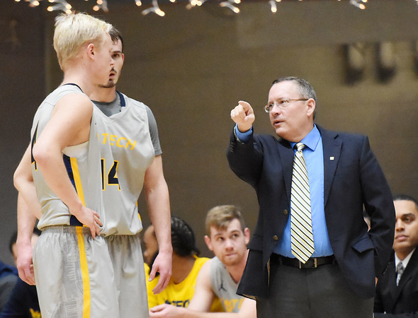 WVU Tech head coach Bob Williams speaks with Andreas Jönsson (4) during the first half of their college basketball game against Ohio Christian in Beckley on Tuesday. (Chris Jackson/The Register-Herald)