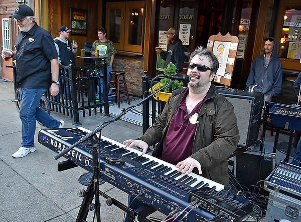 (Brad Davis/The Register-Herald) Local musician Randy Gilkey jams the evening away outside of Foster's during  Celebrity Night Monday evening.