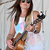 (Brad Davis/The Register-Herald) Krista Hughes jams during the Friends of Coal Auto Fair July 15 at the Raleigh County Memorial Airport.