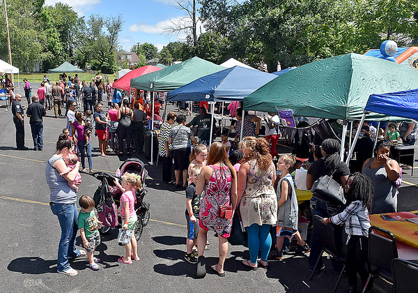 (Brad Davis/The Register-Herald) The scene at Heart of God Ministries' Back to School picnic Saturday afternoon at the church's Kanawha Street location.