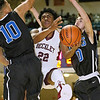 (Brad Davis/The Register-Herald) Woodrow Wilson's Isaiah Francis cuts through Teays Valley Christian defenders Steven Verplancken, left, and Skylar Sigman on his way to the basket during the opening night of the Battle for the Armory Basketball Tournament Thursday night at the Beckley-Raleigh County Convention Center.