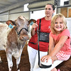 (Brad Davis/The Register-Herald) Four-year-old Gracie Moore, her mom Page and cow Babe at the State Fair Aug. 18 in Fairlea.