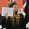 (Brad Davis/The Register-Herald) Summers County High School graduate Isabella Kellar waves to friends and family after collecting her diploma during the school's commencement ceremony Friday evening in Hinton.