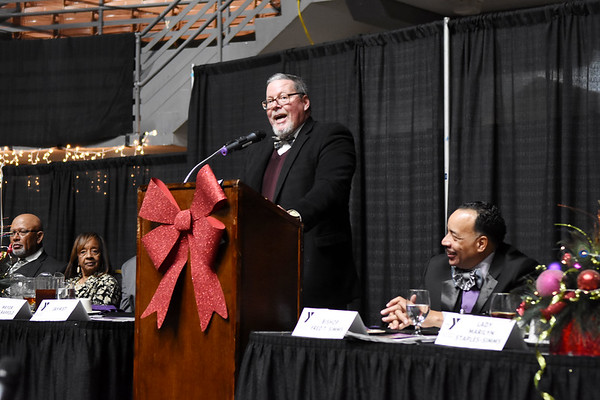Scott Hill, a Spirit of Beckley Award Co-Chair, speaks about Bishop Fred T. Simms during the 31st annual Spirit of Beckley Award at the Beckley-Raleigh County Convention Center in Beckley on Monday. Simms was the recipient of the award. (Chris Jackson/The Register-Herald)