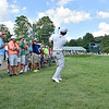 (Brad Davis/The Register-Herald) Greenbrier Classic winner Xander Schauffele shoots with a small crowd around him after his fairway shot on #17 went left and into the gallery during final round Greenbrier Classic action Sunday afternoon in White Sulphur Springs.