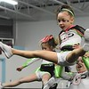 Makynlee Lewis in air and Kaidence Donnelly picking her up, both are with the GymFinity All-Stars team Cosmo and are preparing for a  traveling cheerleading competition.