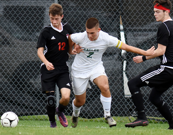 Robert C Byrd's Emilio Buffey (2) vies for possession with Weir's Ashton Knuutila (12) during the West Virginia State Soccer Tournament in Beckley on Friday. (Chris Jackson/The Register-Herald)