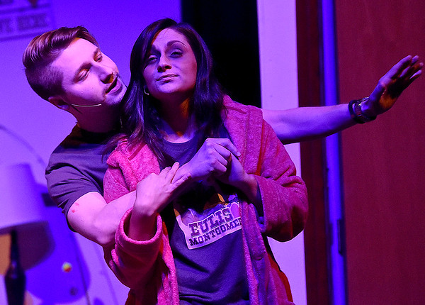 """(Brad Davis/The Register-Herald) Sissy gets a """"visit"""" from idol Eulis during a scene from FRACK! Saturday night at The Raleigh."""