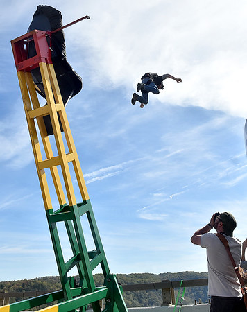 (Brad Davis/The Register-Herald) Columbus, Georgia resident Nick King is launched into the air by a giant catapult during Bridge Day Saturday afternoon.