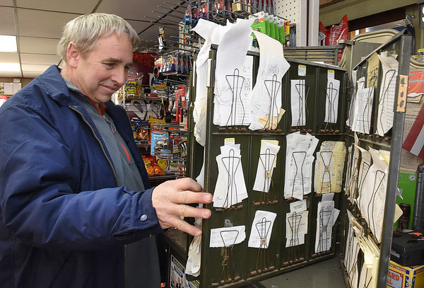 Gary Jarrell, owner, allows costumers to puchase stuff with store credit and looks over costumer receipts at Charles B. Jarrell General Store on Coal River Road in Dry Creek<br /> (Rick Barbero/The Register-Herald