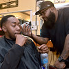 "(Brad Davis/The Register-Herald) Beckley resident Frank Poindexter gets a haircut from Beckley Barber Shop owner Sean ""Slugg"" Stevens at the shop's 130 South Heber Street location Wednesday afternoon."