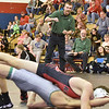 (Brad Davis/The Register-Herald) Fayetteville High School wrestling coaches Shawn Coleman, left standing, and Wayne Yonkelowitz, right of Coleman, shout instructions and react to events on the mat as his wrestler Kris Wilson, bottom, takes on Liberty's Aaron Clark in a 145-pound weight class matchup during the Class AA/A Region 3 Tournament Friday night at Independence High School. Liberty's Clark would win the match.