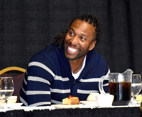 (Brad Davis/The Register-Herald) Arizona Cardinals receiver Larry Fitzgerald takes in the atmosphere at the Big Atlantic Classic Tip-Off Banquet Sunday afternoon at the Beckley-Raleigh County Convention Center.