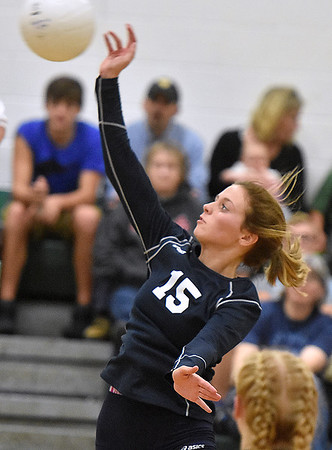 (Brad Davis/The Register-Herald) Meadow Bridge's Makenzie Judy taps the ball across during a volleyball match against Fayetteville Wednesday night at Fayetteville High School.
