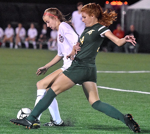 (Brad Davis/The Register-Herald) Greenbrier East's Emma Dotson battles for possession with Cabell Midland's Harper True during Class AAA Girls State Soccer Tournament action Friday night the YMCA Paul Cline Memorial Sports Complex.