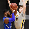 WVU Tech's Michael Scott (31) defends against Ohio Christian's Rael Windley (23) during the first half of their college basketball game against Ohio Christian in Beckley on Tuesday. (Chris Jackson/The Register-Herald)