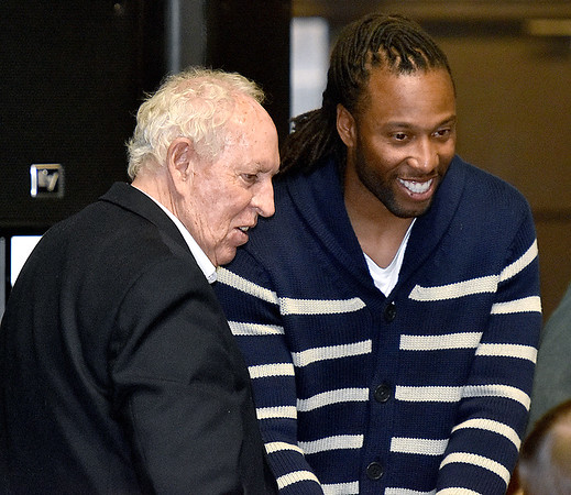 (Brad Davis/The Register-Herald) Former coach Dave Barksdale chats with Arizona Cardinals receiver Larry Fitzgerald during the Big Atlantic Classic Tip-Off Banquet Sunday afternoon at the Beckley-Raleigh County Convention Center.