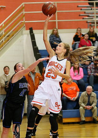 (Brad Davis/The Register-Herald) Summers County's Gavin Pivont drives and scores as Midland Trail's Wilson Jenny defends Thursday night in Hinton.