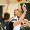 (Brad Davis/The Register-Herald) Westside's Shawn Jenkins drives to the basket as Wyoming East's Dylan Brehm defends Friday night in Clear Fork.