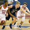 (Brad Davis/The Register-Herald) Greenbrier West's D.J. Oxendine races for a loose ball at mid court with Independence's Markus Guy, left, and Logan Kelly Wednesday night in Coal City.