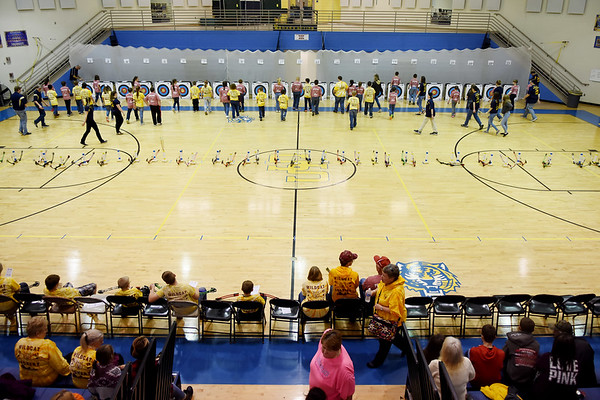 Students from various elementary schools gather their arrows during a competition at Shady Spring Middle School Saturday. (Chris Jackson/The Register-Herald)