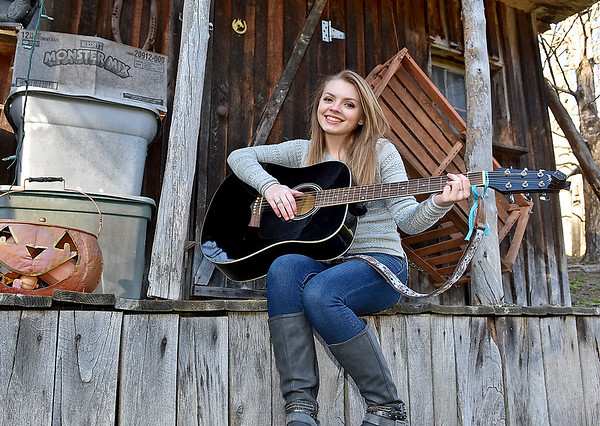 (Brad Davis/The Register-Herald) Liberty High senior Kitty Dunbar at her Clear Creek home Sunday afternoon.