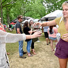 (Brad Davis/The Register-Herald) Sarah Houck, right, lets friend Amber Lilly try some of the wine she's trying during Daniel Vineyards' Spring Wine Festival Saturday afternoon in Crab Orchard.