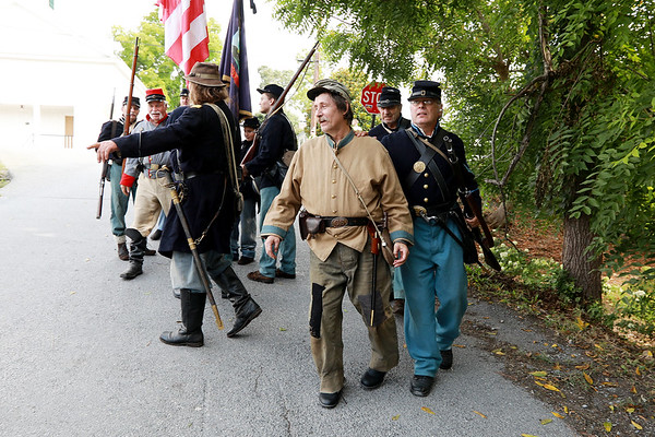 Civil War re-enactors portraying the Federal Army capture the local Home Guard during a battle between the local Home Guard and the Federal Army as part of Monroe County Heritage Day in Union on Saturday.  (Chris Jackson/The Register-Herald)