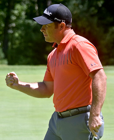 (Brad Davis/The Register-Herald) Chad Griffith reacts with a fist pump after nailing a birdie putt on #15 during BNI action Sunday afternoon at Glade Springs' Stonehaven Golf Course.