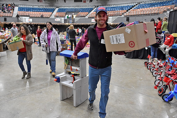 (Brad Davis/The Register-Herald) Scenes from the annual Mac's Toy Fund event Saturday morning at the Beckley-Raleigh County Convention Center.