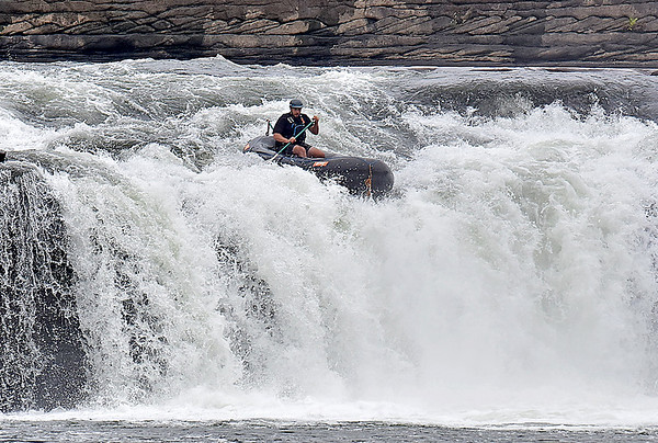 (Brad Davis/The Register-Herald) A rafter navigates his way down during the freestyle portion of Kanawaha Falls Fest Thursday morning in Gauley Bridge.