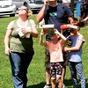 Jessica and Travis Kesterson, of Boomer, look at the solar eclipse with their two children, Kinsley, 5, and Kara Kesterson, 8, Monday afternoon at Grandview State Park.<br /> (Rick Barbero/The Register-Herald)