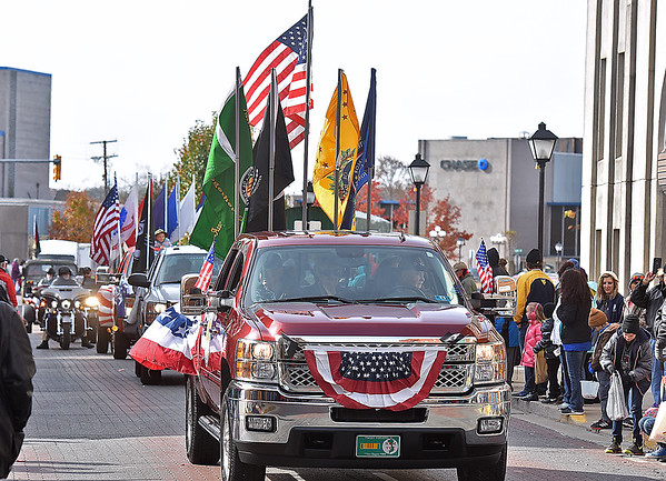 (Brad Davis/The Register-Herald) Beckley's annual Veterans Day Parade cruises up Neville Street Saturday morning.