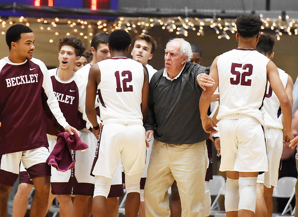 Woodrow Wilson assistant coach Dave Barksdale congratulates his side during a timeout during their seasons opener against Spring Valley Tuesday in Beckley. (Chris Jackson/The Register-Herald)