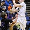 (Brad Davis/The Register-Herald) Shady Spring's Stephen Williams drives and scores as James Monroe's Connor Moore defends Wednesday night at Shady Spring Middle School.