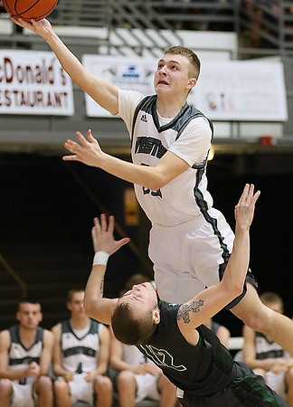 (Brad Davis/The Register-Herald) Westside's Jacon Ellis drives to the basket through Wyoming East's Johnathan Simms during the Class AA Region 3, Section 1 championship game Saturday night at the Beckley-Raleigh County Convention Center.