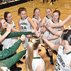 (Brad Davis/The Register-Herald) The Wyoming East Lady Warriors, defending state champs in class AA, get fired up prior to their championship game in the class AAA bracket against the St. Albans Red Dragons Saturday evening at the Big Atlantic Classic inside the Beckley-Raleigh County Convention Center.