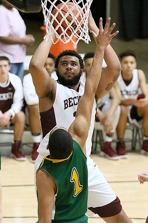(Brad Davis/The Register-Herald) Woodrow Wilson's Tarek Payne drives to the basket as Greenbrier East's Jasiah Rawls defends during the Flying Eagles' Sectional Championship victory over the Spartans Friday night at the Beckley-Raleigh County Convention Center.