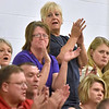 (Brad Davis/The Register-Herald) Community members react in support of fellow residents speaking out against the possible closing of Valley High School during a public hearing Thursday evening in Smithers.